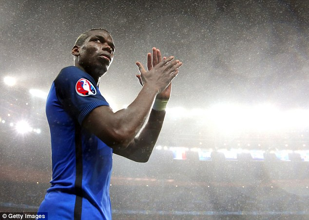 Paul Pogba applauds the fans at the Stade de France following the 5-2 quarter-final win over Iceland