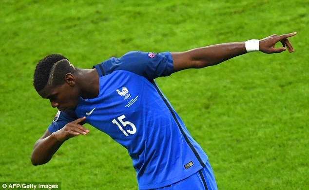 Pogba celebrates after doubling France's lead in only the 19th minute of the match on Sunday night