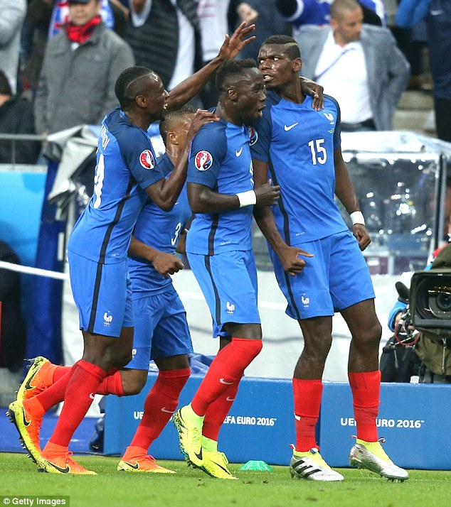 The former Manchester United midfielder is congratulated by team-mates Bacary Sagna and Blaise Matuidi