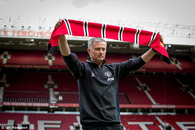 The 53-year-old tactician displays a Red Devils scarf as he held his first press conference as United manager