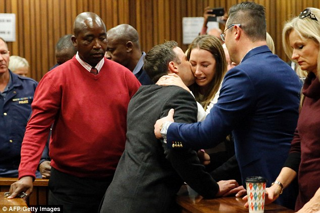 Oscar Pistorius holds his sister Aimee Pistorius as he leaves the High Court following his sentencing today