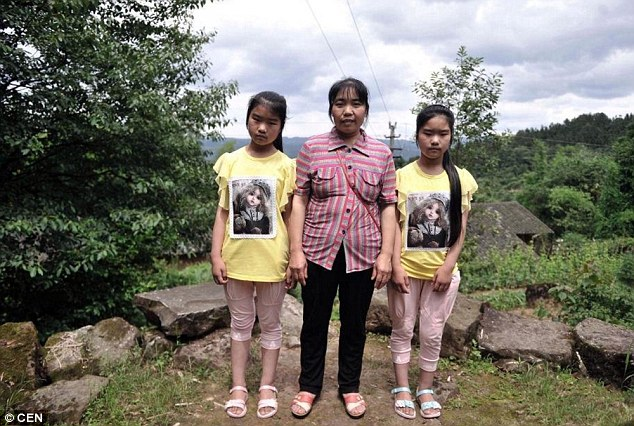 Twins: Two sisters stand with their mother wearing identical clothing in Qingyuan village
