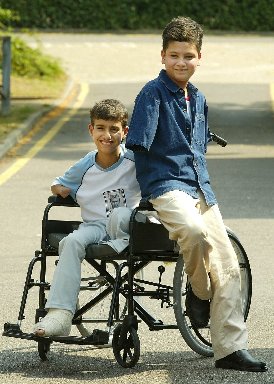 Recovery: Ali Abbas, right and Ahmed Hamza, left, were flown to Britain for treatment after the US missile attack in which he lost his arms