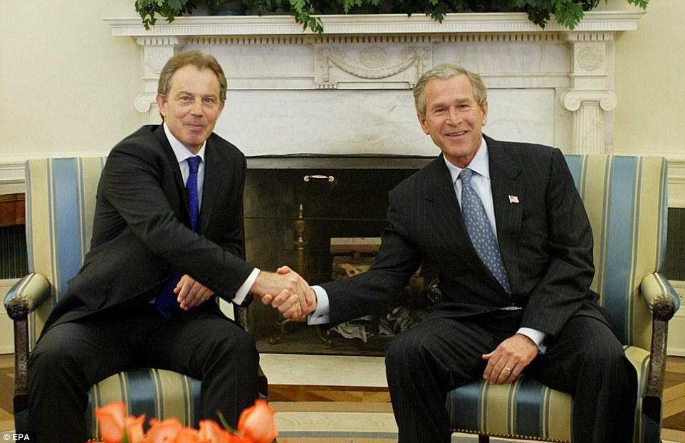 Special relationship: George W. Bush  greets British Prime Minister Tony Blair in 2004 - Mr Blair had told him after 9/11: 'Act now, explain later', a secret memo revealed