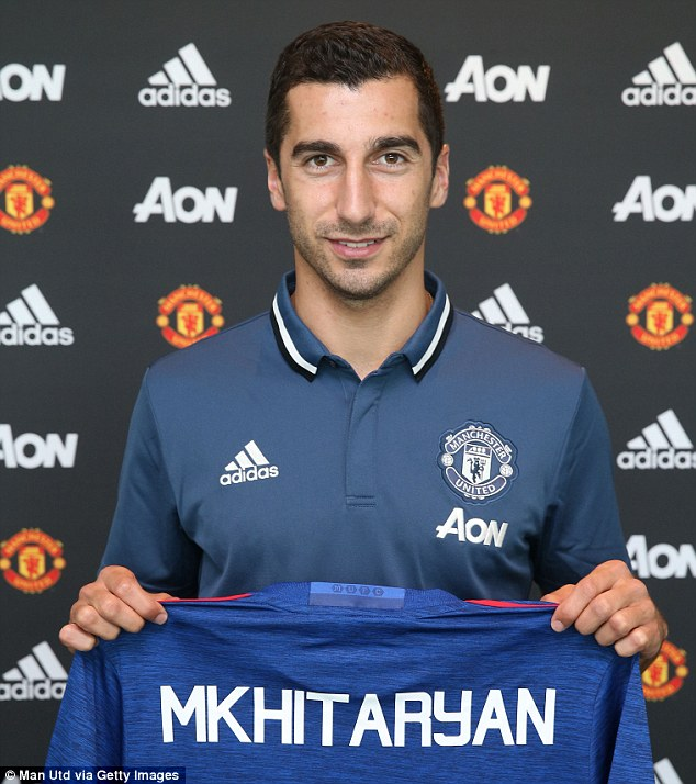 Henrikh Mkhitaryan has signed a four-year deal at Manchester United after completing a medical