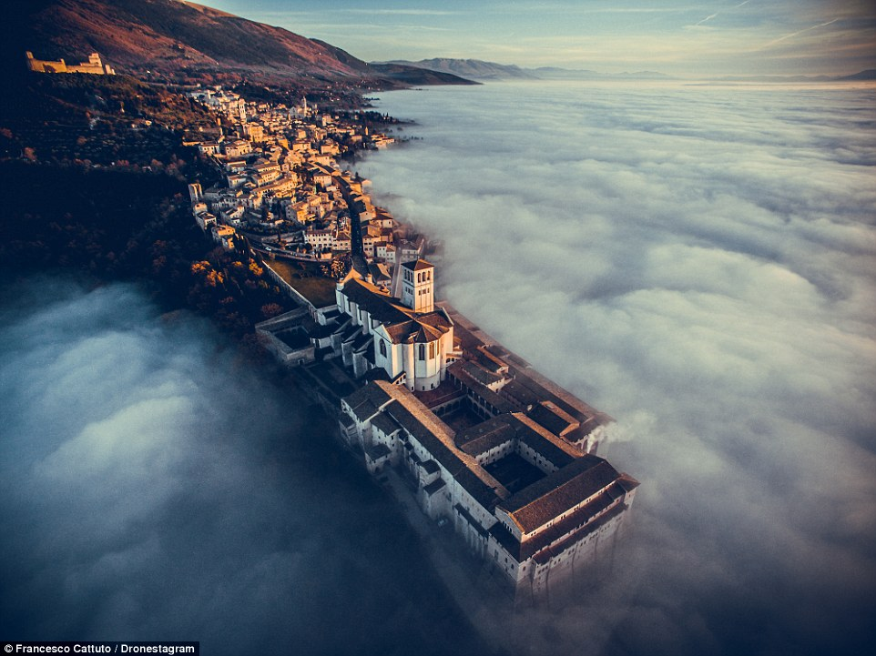 First place, travel: Basilica of Saint Francis of Assisi in  Italy was captured in this mesmerising shot on a foggy day just after Christmas by Francesco Cattuto. The photographer had gone on a walk with his girlfriend and was astonished when he saw the results of this drone shot