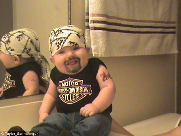 It's a truth universally acknowledged... that leaving dad at home alone with the kids is just asking for trouble. Pictured: A barmy dad gives his 'biker' baby a beard and tattoo