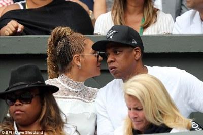 Sweet nothings? The Lemonade singer was seen whispering in her husband's ear