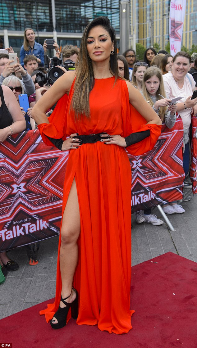 Ravishing in red: Nicole Scherzinger stole the show as she arrived at Wembley Arena in London on Saturday alongside her fellow X Factor judges Simon Cowell, Sharon Osbourne and Louis Walsh