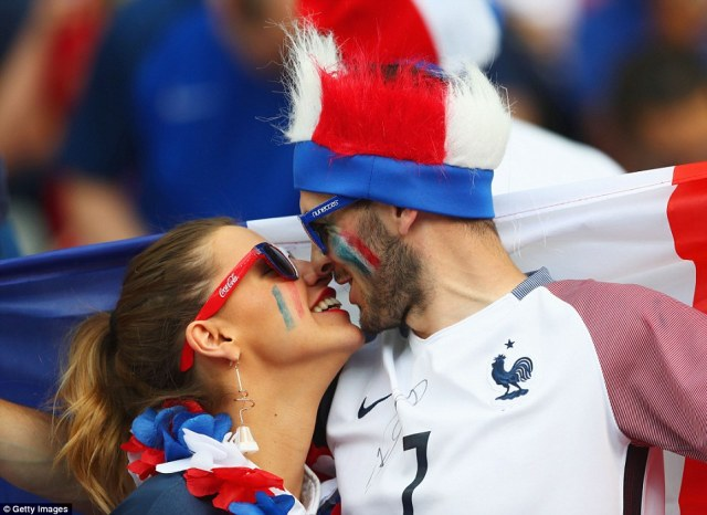 French fans enjoy the atmosphere prior to the start of the European Championship final match between Portugal and France this evening