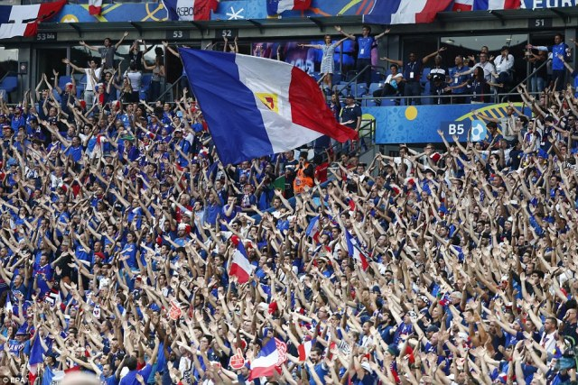 In full voice: French supporters before the Euro 2016 final match between Portugal and France at Stade de France in Saint-Denis