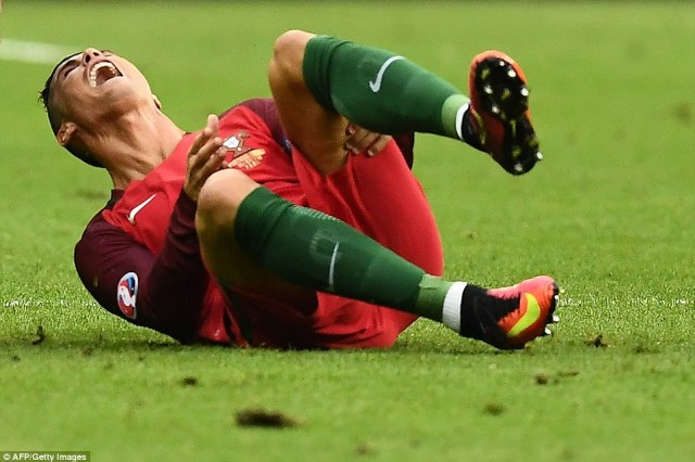 In tears: France and Portugal are battling it out to be crowned champions of Euro 2016 with the two teams being cheered on by 80,000 fans in Paris. But there has been a huge setback for Portugal after captain Ronaldo was forced off the pitch through injury 25 minutes in
