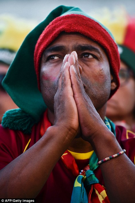 A Portuguese fan looks nervous as he watches the game from the Terreiro do Paco square
