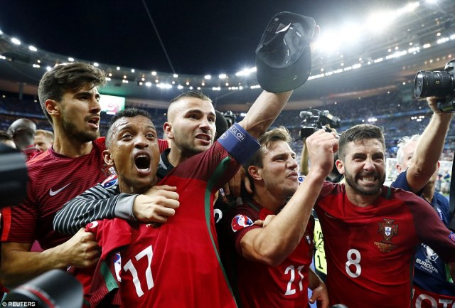Portugal's Nani (centre) celebrates alongside his team-mates after the country were crowned the unlikely victors of Euro 2016 in France