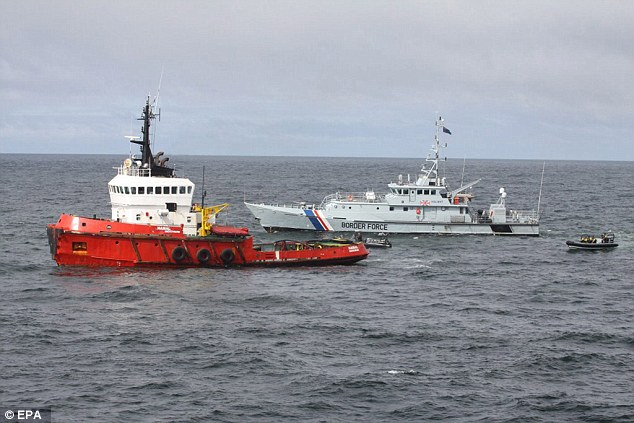 MV Hamal being boarded by a team from the Royal Navy  last April. Three tonnes of cocaine was onboard