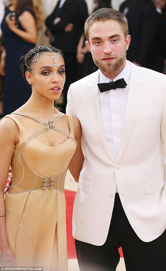 All change: The stunning singer usually has black hair - pictured here with her fiancé Robert Pattinson back in May at the Met Gala