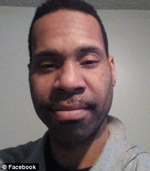 Corey Menafee, 38, knocked out a stained glass window at Yale depicting slaves in a cotton field