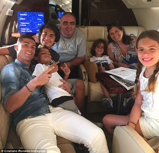 Cristiano Ronaldo (left) took to Instagram on Tuesday as he jetted off to enjoy a holiday with his family