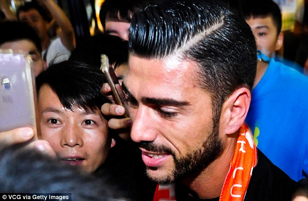 Pelle was greeted by jubilant fans after landing in China following his £13million arrival from Southampton