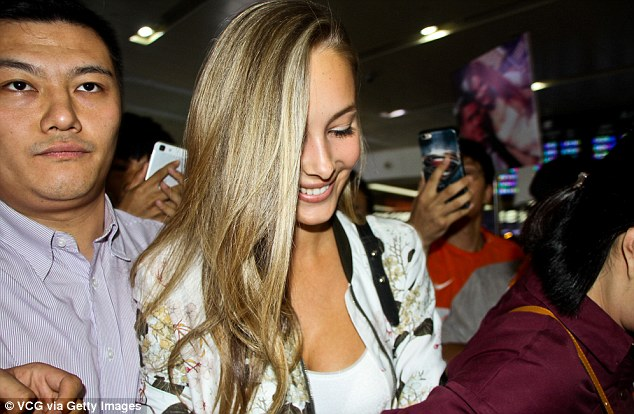 Pelle was joined by his model girlfriendViktoria Varga as they made their way through the airport in Jinan