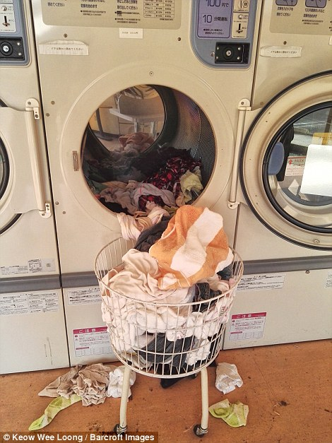 Clean laundry left half in washing machines show the panic that followed the disaster