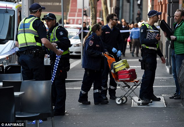 Witnesses heard 'gut-wrenching' screams after a woman, 31, and a four-month-old baby died when they plunged to their deaths from a balcony in central Melbourne. Police speak to a witness