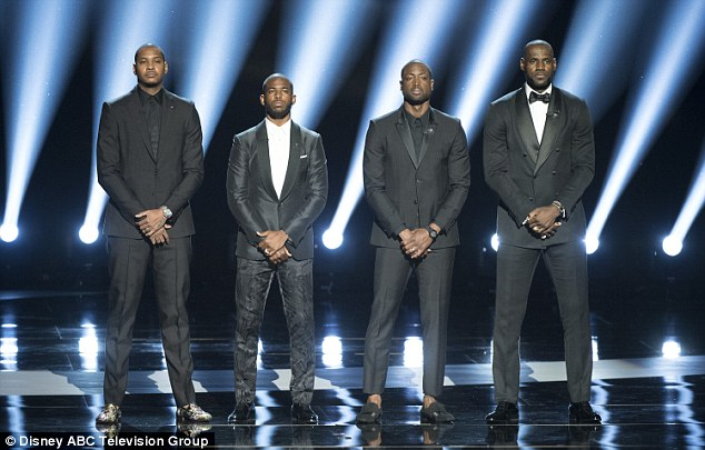Carmelo Anthony, Chris Paul, Dwyane Wade and LeBron James pose for a picture on the stage