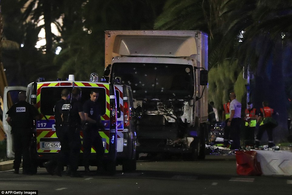 A truck ploughed through a large group of people in Nice during a suspected terrorist attack which claimed 'dozens of lives'