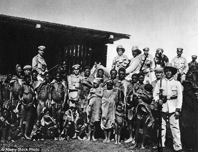 German troops pose for a photo with tribe members during the genocide from 1904 to 1908