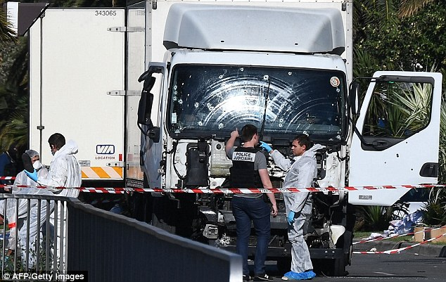 Terror attack: At least 84 people were killed and dozens more critically injured last night when a terrorist killer, named locally as Mohamed Lahouaiej Bouhlel, drove this truck, riddled with bullets, through crowds celebrating Bastille day in Nice