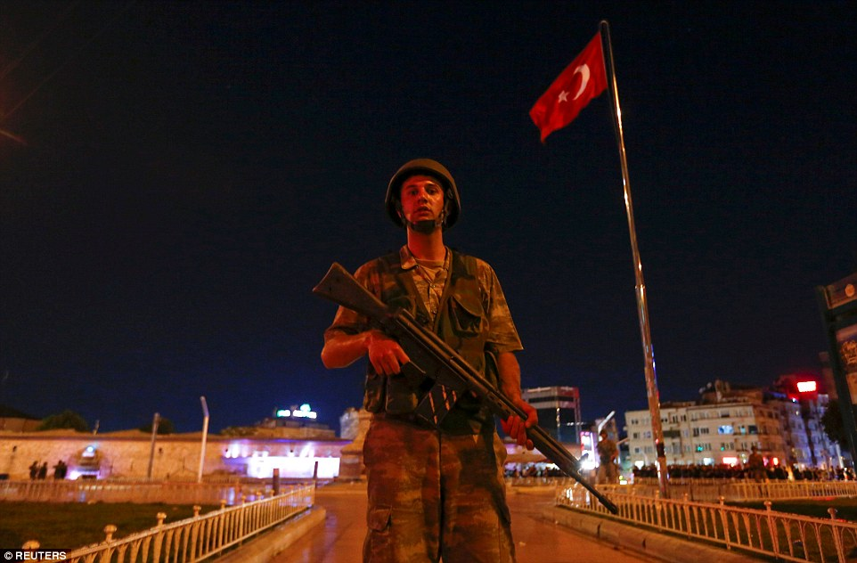 Turkish troops have seized Taksim Square in Istanbul amid conflicting reports that they have successfully overthrown the government