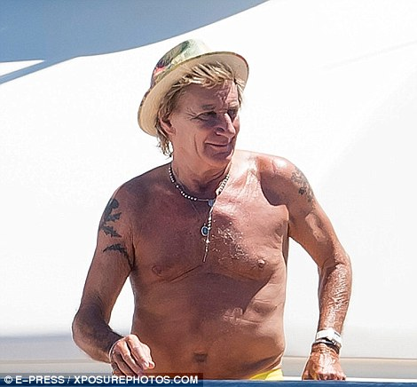 Da Ya Think Im Sexy Shirtless Rod Stewart 71 Flexes His Guns As He Suns Himself Onboard A