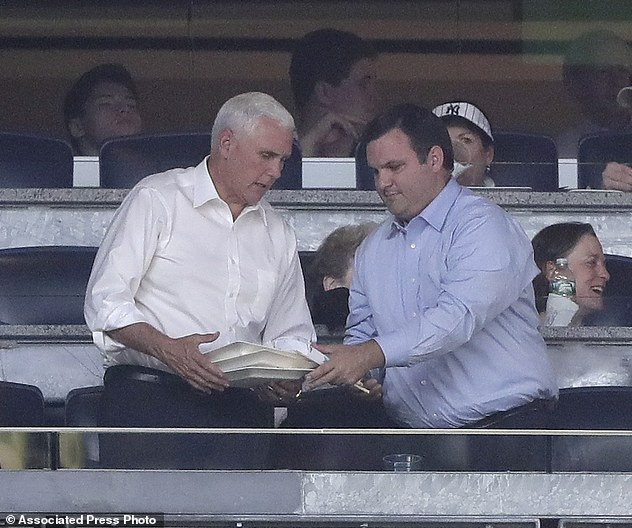 Pence, left, sat in the owner's box at Yankee Stadium for a baseball game between the New York Yankees and the Boston Red Sox on Friday night after meeting with Trump in his Manhattan office and taping an interview with Fox News Channel host Sean Hannity