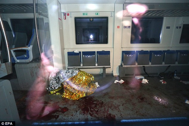 Gruesome pictures taken in the hours after the attack show the blood-soaked interior of the train
