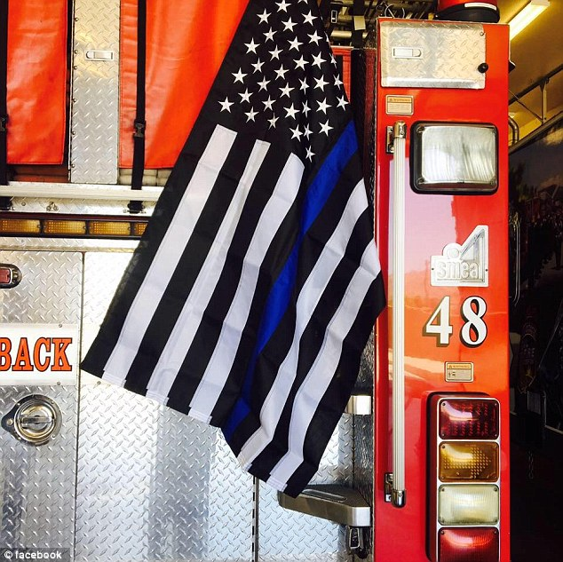 California firefighters have been forced to remove a flag honoring the police officers killed in recent weeks over 'extremist' fears