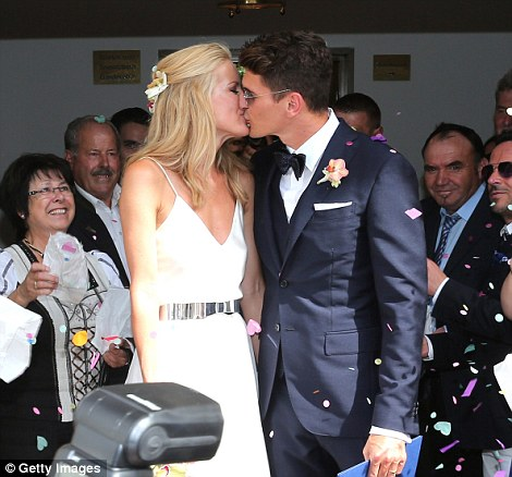 Goal!The couple were a vision of happiness as they shared a kiss in front of their friends and family