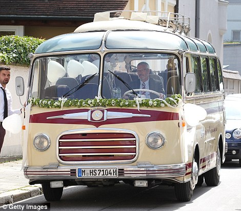 Honeymooners: The couple made a swift getaway in a vintage car, whilst a bus was provided for the guests to head home