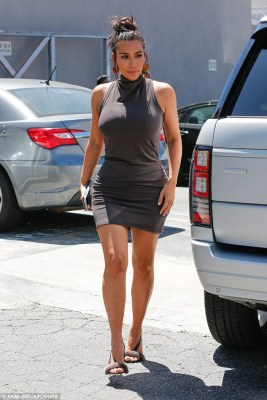 Always on trend: The only accessory Kim carried was her iPhone6 - to capture life for Snapchat