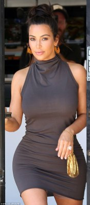 Kim's secret:As she left the hair salon, the reality star's skirt rode up, revealing the briefest of glimpses at the shapewear she wore beneath