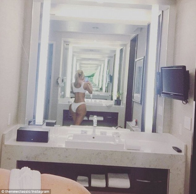 Cheeky! Social media users have accused Iggy Azalea of getting butt implantsafter the 26-year-old Australian rapper shared a revealing bathroom selfie on Friday