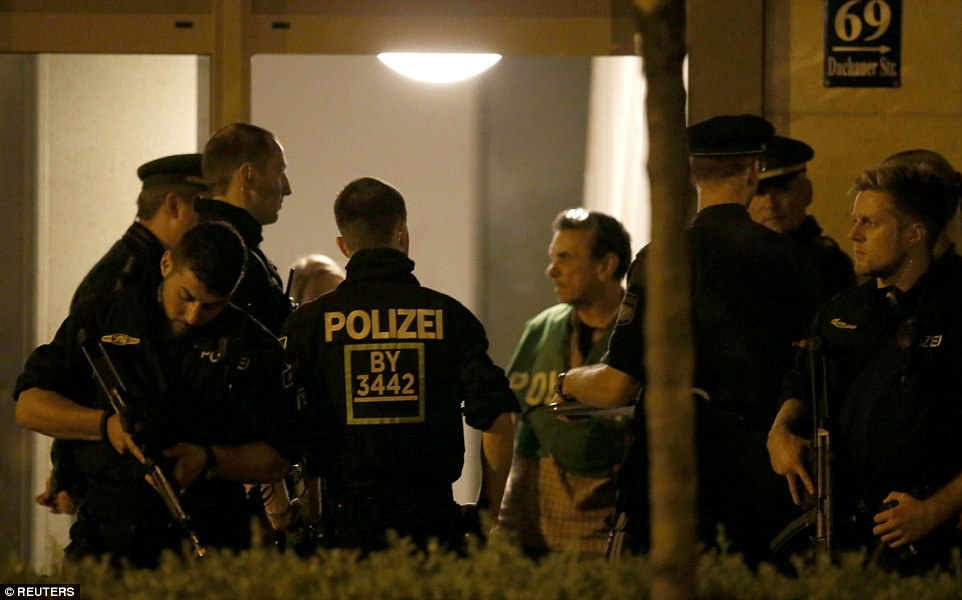 Heavily-armed police raided the apartment of the Iranian teenager, named as Ali David Sonboly, suspected of murdering nine people and injuring 16 others in a rampage in Munich yesterday.