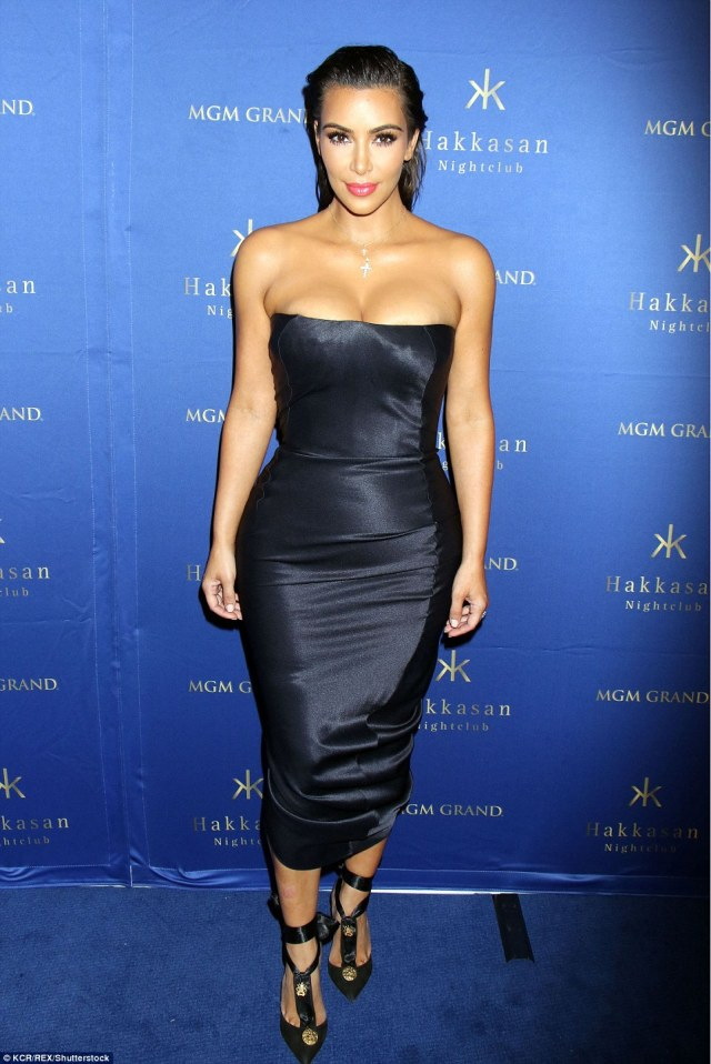 Sizzling: On Friday evening Kim Kardashian turned up the heat in a strapless silk ankle length dress in Las Vegas which showed off her hourglass figure to perfection