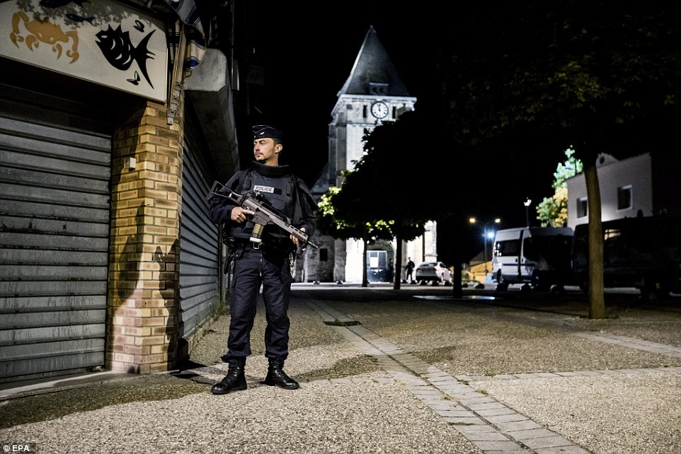 French riot police guard the church in Saint-Etienne-du-Rouvray where a fatal hostage taking incident happened, near Rouen