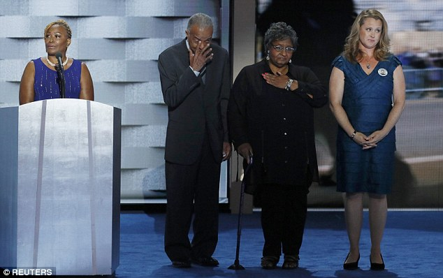 Family members of fallen law enforcement officers stand onstage on the final night of the Democratic National Convention in Philadelphia