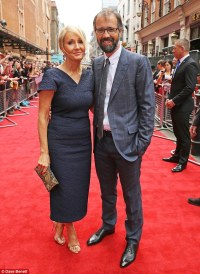 J.K Rowling stuns in navy dress as she makes rare red ...