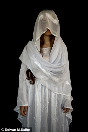IS abducted 5,000 Yazidi women in Iraq in 2014. Some of those who escaped were pictured in traditional wedding dresses to help illustrate their ordeal
