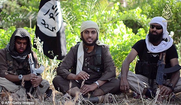 Three of the most notorious British jihadis who have joined Islamic State in Syria all worshipped at the controversial Al-Manar mosque. Reyaad Khan,  left, and Nasser Muthana, then both 20, centre, appeared in an IS recruiting video in 2014 ¿ a year before Khan¿s death in an RAF drone strike. Muthana¿s younger brother Aseel, then aged 17 and who is not pictured, joined them in Syria. The trio became known as the ¿Cardiff jihadis¿
