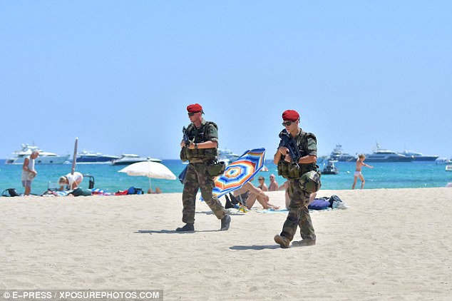 Armed police have been seen patrolling the beaches in St Tropez as security is ramped up in the light of the latest terror attacks to hit France