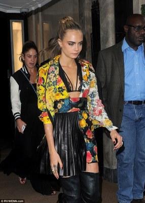 Bold: She flashed her racy lace bralet beneath a kimono-style dress