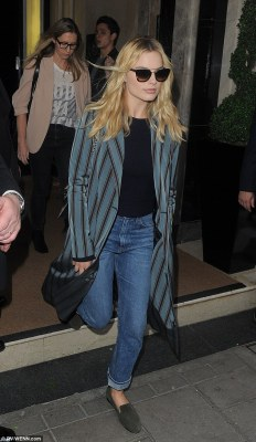 Low-key: Margot Robbie kept things casual in a long coat and flat slip-ons